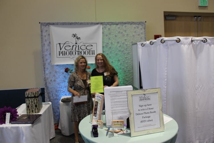 Mandy is on the right and Katja from Venice Photo Booth on the left handing out the gift certificate