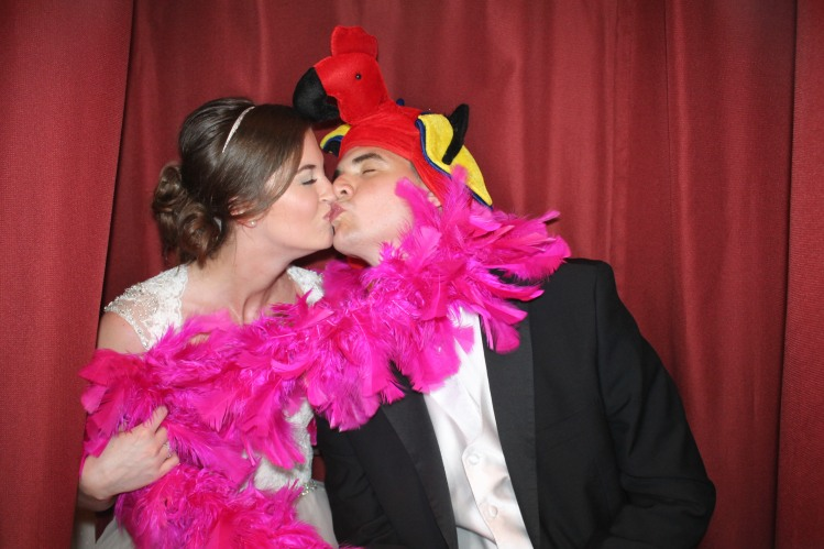 bridegroomkissing in photobooth Venice